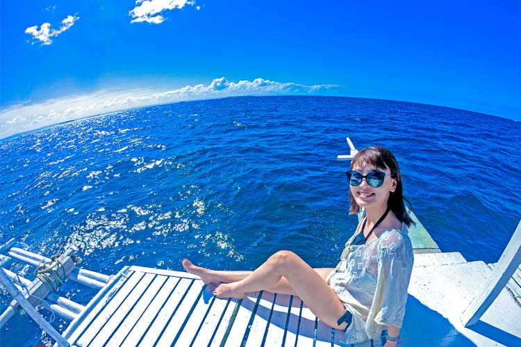 Riding a boat going to your Island destinations.