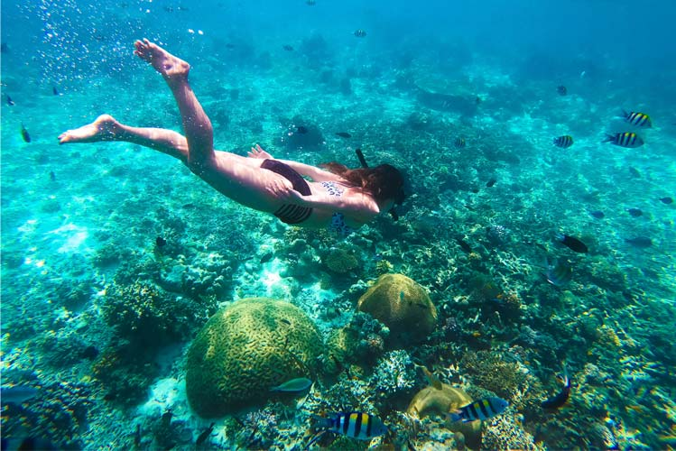 Try some snorkeling while in the Island.